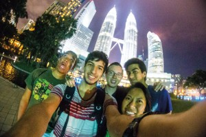Honors tour members take a selfie in Kuala Lumpur, Malaysia, with the Petronas Towers in the background.